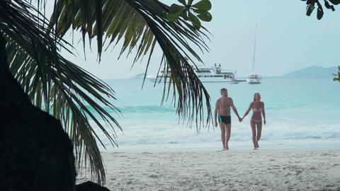 Seychelles. Praslin Island. Happy couple resting on the beach on island. Pretty Footage