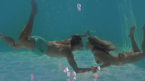 Animation of couple in a swimming pool against of little pink hearts Animation