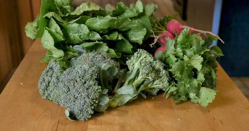 Seasonal fresh organic vegetables from a farmers market including collard greens, broccoli florets, Footage
