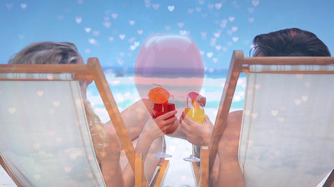 Animation of a couple sitting on chairs at the beach against pink hearts Animation