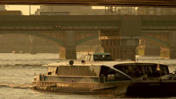 A Thames Clipper Riverbus speeds under London Bridge Footage