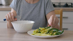 Woman cuts the tips of green and yellow beans and prepares vegetable meal Live Action