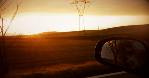 shot on a rear view mirror of a sunset with nature in Live Action