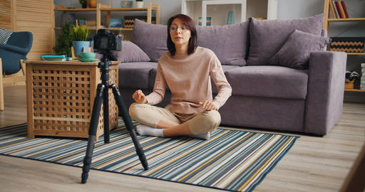 Cheerful woman speaking gesturing recording video at home for online blog Footage