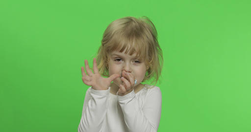 Happy little blonde girl in white t-shirt. Cute blonde child. Making faces Footage