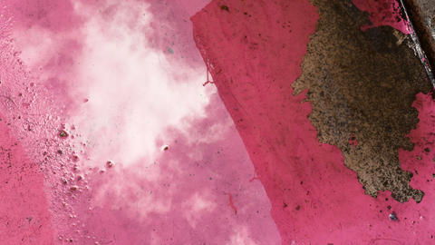 reflection of a building and clouds in a puddle on the famous Rua Cor de Rosa Footage