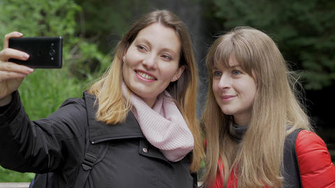 Young women on their journey to Glencar Waterfall in Ireland Footage