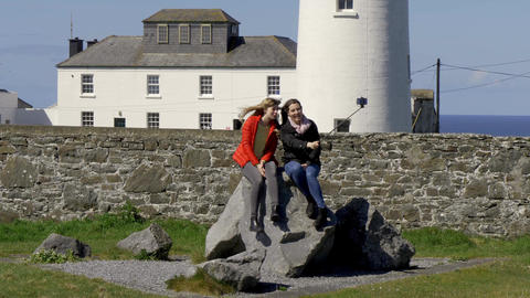 Two young woman on their journey along the Irish west coast Footage