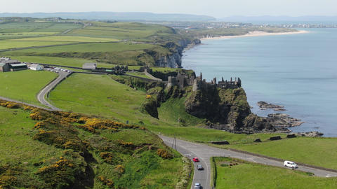 Aerial view over famous Dunluce Castle in North Ireland Footage