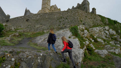 Two girls on their journey in Ireland visit the famous Rock of Cashel Footage