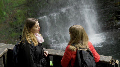 Young woman enjoys the beautiful nature in Ireland Live Action