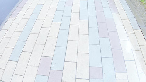 Paving slabs and footpath after rain Footage