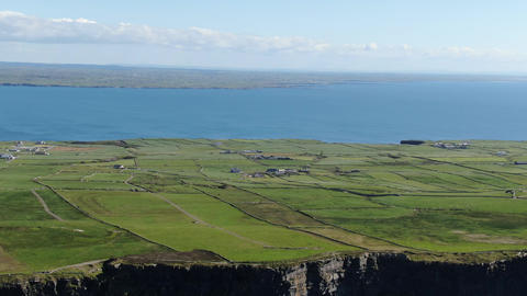The green lands at the Cliffs of Moher in Ireland Live Action