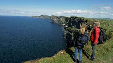 Two girls at the famous Cliffs of Moher in Ireland Live Action
