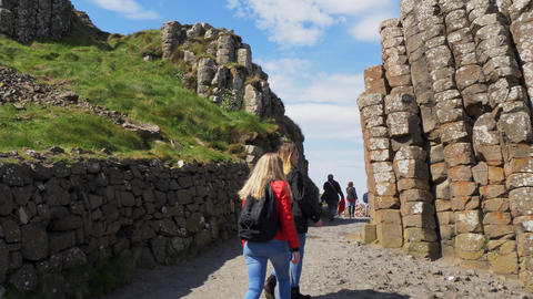Visitors at Giants Causeway in Northern Ireland - BUSHMILLS. NORTHERN IRELAND - Live Action