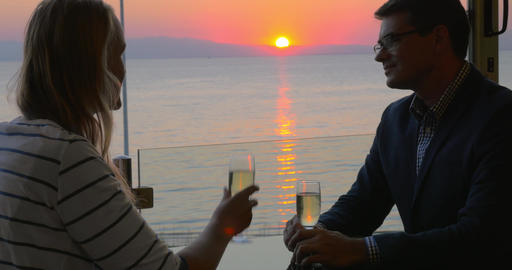 Couple on romantic date at seaside cafe Footage