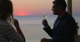 Loving couple enjoying romantic evening in seaside cafe Footage