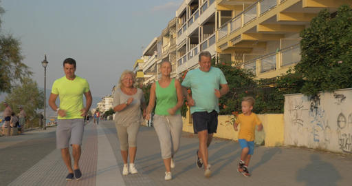 Cheerful big family going in for sport together Footage