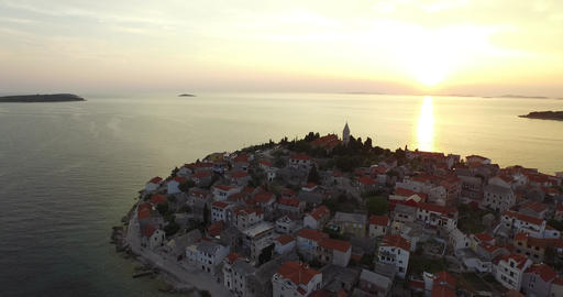 Aerial drone scene of Croatian town at sunset. Camera travels quickly to the tow Footage