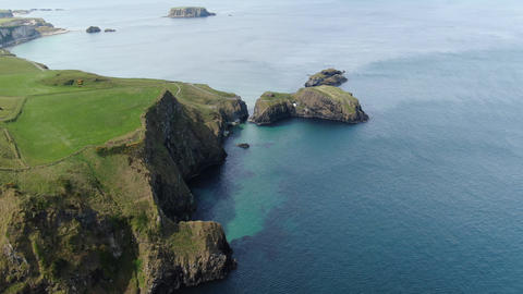 Flight over Carrick-A-Rede Rope Bridge - a famous landmark in North Ireland Live Action
