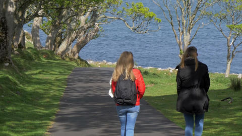 Two young women on their journey along the causeway coast in Northern Ireland Footage