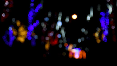 Blurred background of the street with colorful lights at night Acción en vivo