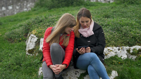Girl watches photos on her cellphone Footage
