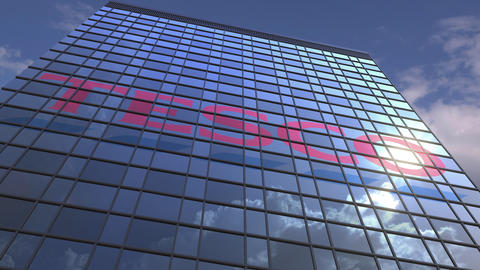 Logo of TESCO on a media facade with reflecting cloudy sky, editorial animation Live Action