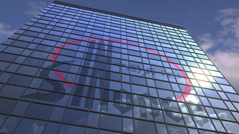 Logo of SINOPEC on a media facade with reflecting cloudy sky, editorial Live Action