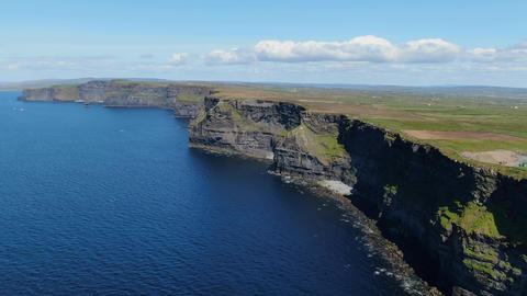 Flight along the famous Cliffs of Moher in Ireland Live Action