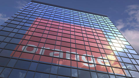 Logo of ORANGE on a media facade with reflecting cloudy sky, editorial animation Live Action