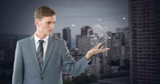 Digital animation of a businessman holding a turning globe in his hand 4k Live Action