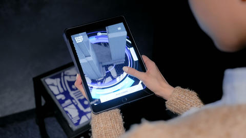 Woman using digital tablet with architecture augmented reality app Footage