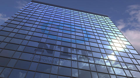 Logo of NTT on a media facade with reflecting cloudy sky, editorial animation Footage