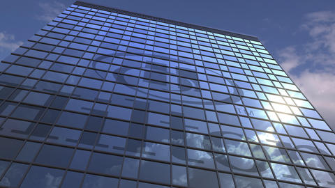 Logo of HILTON on a media facade with reflecting cloudy sky, editorial animation Live Action