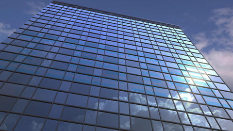 Logo of IBM on a media facade with reflecting cloudy sky, editorial animation Footage