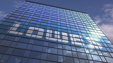 Logo of LOWES on a media facade with reflecting cloudy sky, editorial animation Live Action