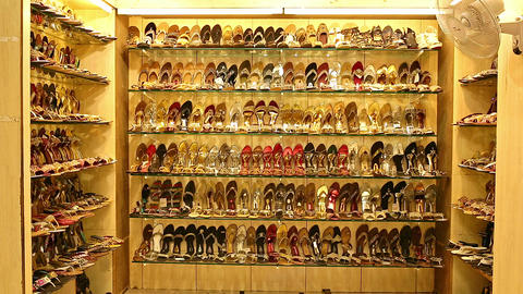 Many types of leather shoes at shoes shop. Exquisite wedding shoes in the store window Live Action