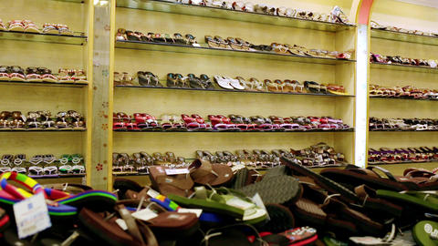 Shopping. closeup bright colored fashionable leather summer shoes and slippers on high heels on Live Action