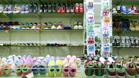 fashion shoes footwear boutique shelves interior, Rows of shelves piled high with new children's Live Action