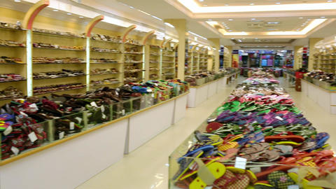 colorful slippers and shoes in a shop. Different slippers selling at the showcase. supermarket Live Action
