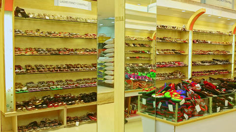 Footwear outlet at mall in India for sneakers, designer classic shoes Footage