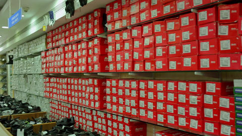 sale of shoes in store. Shelves with fashion shoes in store Live Action