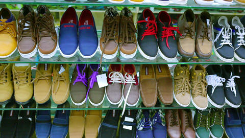 sale of shoes in store. Shelves with fashion shoes in store. Various fashion shoes Live Action
