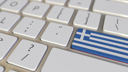 Key with flag of Greece on the computer keyboard switches to key with flag of Footage