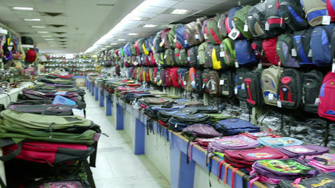Back to school concept. Collection of multi-colored kids school bags on the store shelfs Live Action