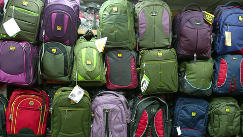 Back to school concept. Purchase of kids school bags, Travel bags cases for sale at the store show. Live Action