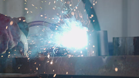 Slow motion of a welder welding construction steel frames Live Action