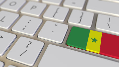 Key with flag of Senegal on the computer keyboard switches to key with flag of Footage