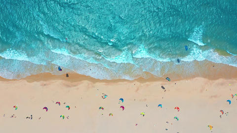 Aerial view. Ocean waves, kitesurfing from the sky in blue ocean Live Action